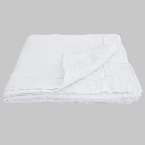 white linen bed cover