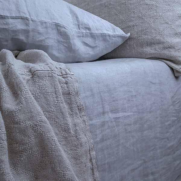 sengetæppe hør natur